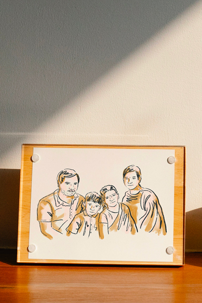 Picture: An illustration of the author's family portrait sits on the sideboard.